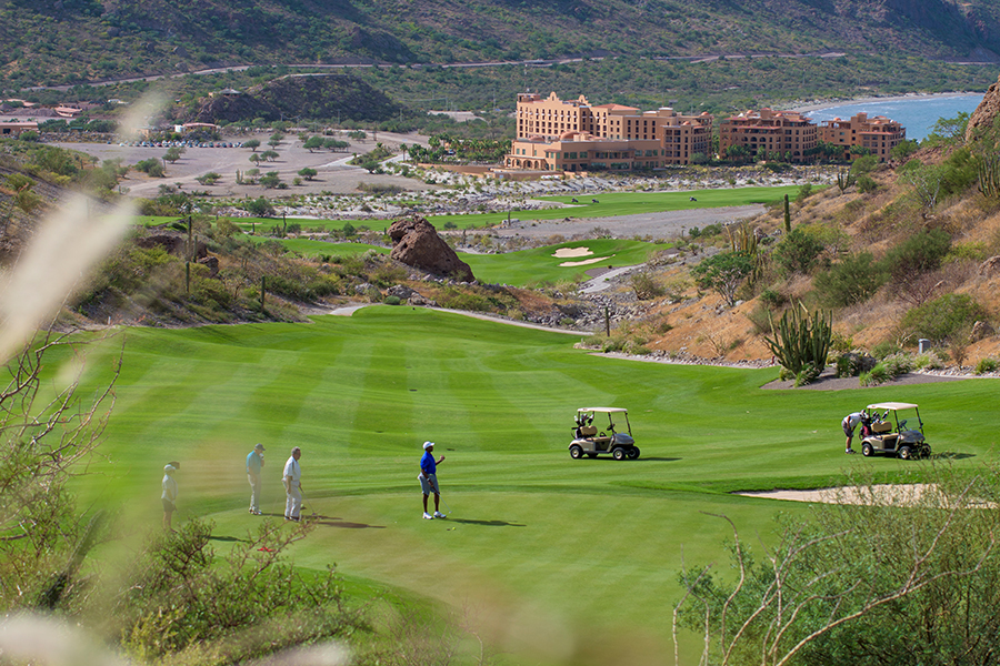 golf cart and players at tpc danzante bay at the islands of loreto golf course