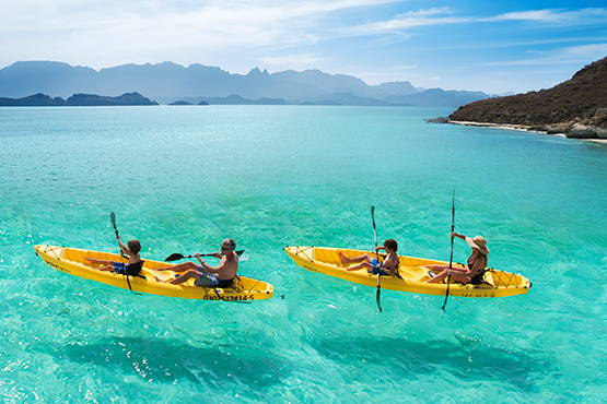 paddle kayak in family at the islands of loreto mexico